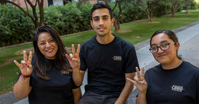 Three students show Forks Up with their hands